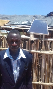 Musa, a leader of Gabimori UMC, with the solar panel he purchased last December.